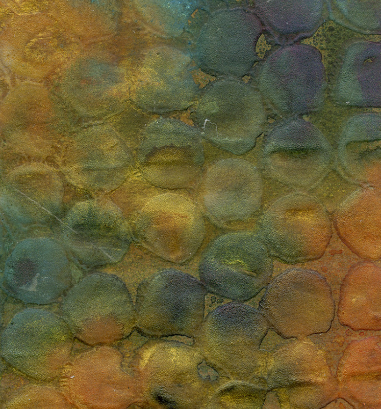 Gesso sprayed with Dylusions on Tim Holtz Kraft Glassine