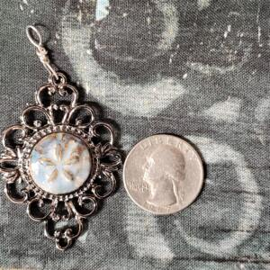 Starfish Ceramic Pendant in Silver Oval Filigree Bezel