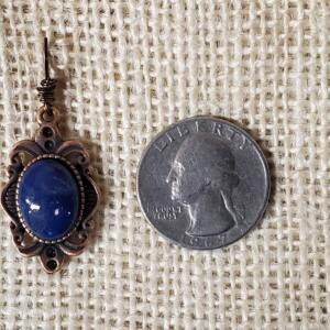 Dark Blue Oval Ceramic Pendant in Copper Filigree Bezel