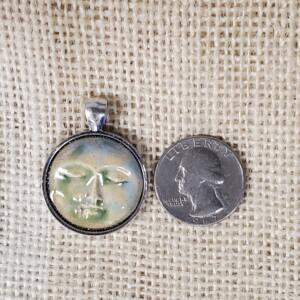 Round Bone Moon Face Ceramic Pendant in Silver Bezel