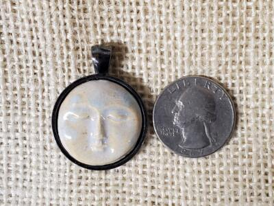 Round Light Blue Moon Face Ceramic Pendant in Silver Bezel