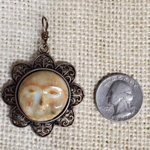 Bone Moon Face Ceramic Pendant in Copper Floral Bezel