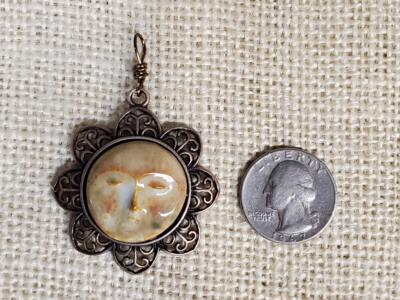 Bone Moon Face Ceramic Pendant in Copper Floral Bezel